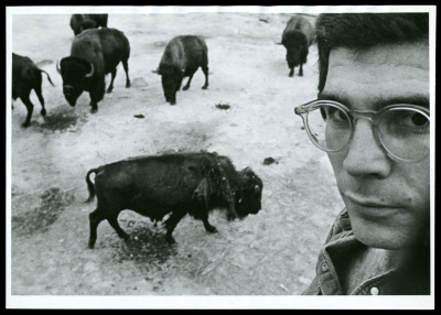 photograph of david mamet in front of american buffalo